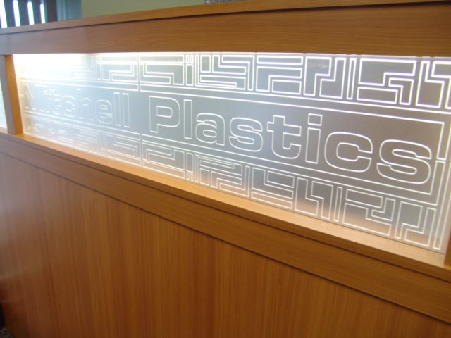 engraved plastic panel with logo