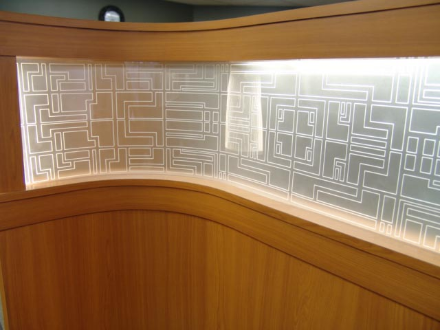 Curved engraved panel