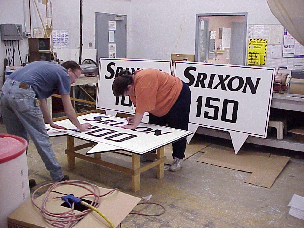 Srixon Sign Kenny & Lisa working on